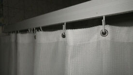 Shower curtain rail