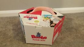 Lovely condition Bumbo seat (pink) for sale