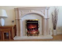 Italian fireplace with marble plinth and electric fire