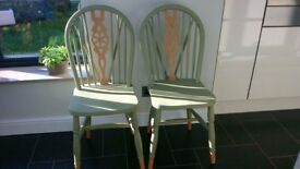 Pair of wheelback dining chairs and seat pads