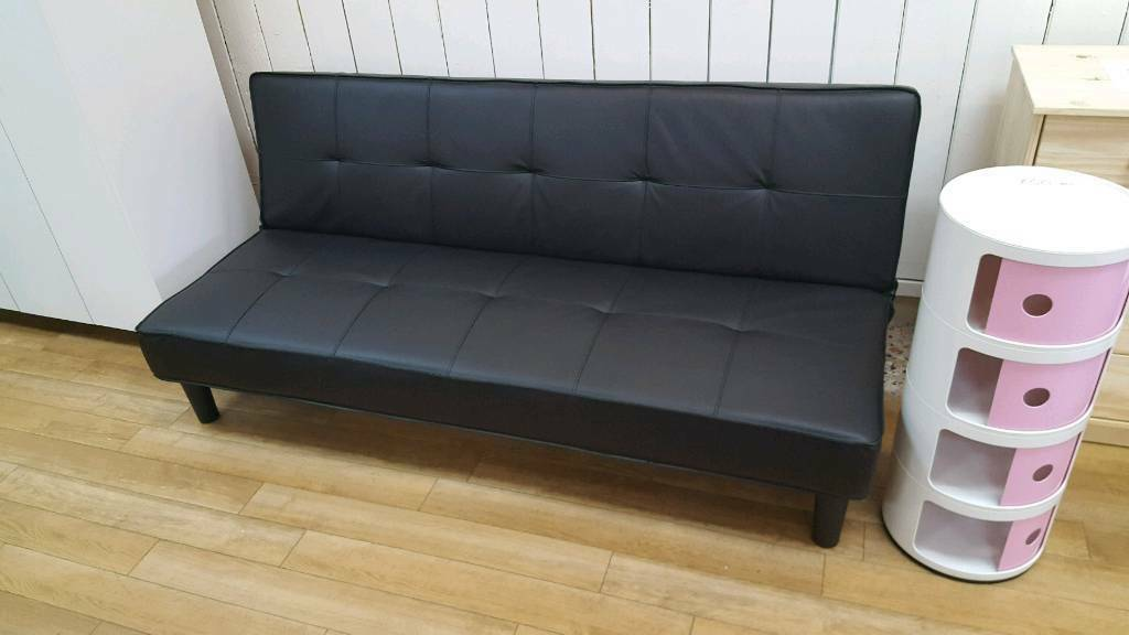 Black PU sofa bed folds down to 4ft bed