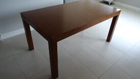 Solid dark wood kitchen table and 4 chairs