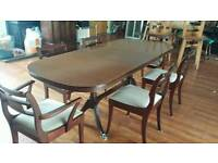 6 seater extending dinning pedistal table with 1 leaf claw feet reduced for quick sale
