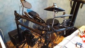 Electric drum kit + stool and amp