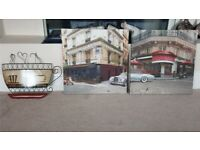 2 canvas print pictures and 1 coffee cup wall art item.