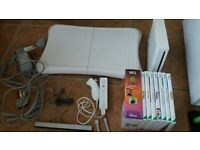 wii console + controller + fit board + 7 games