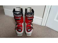 Two Pairs of Ski Boots and White Set of Skis for Sale
