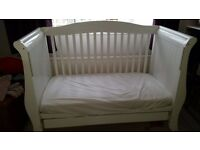 White Sleigh cot bed with mattress and pull out base drawer.