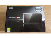 boxed black Nintendo 3DS console