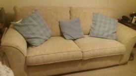 Beige material 3 seater sofa