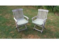 2 folding wooden garden chairs and seat pads