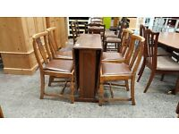 Oak dropleaf table and four leather top chairs