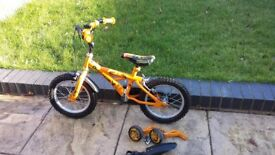 14 inch boys bike hardly used, yellow dinosaur theme. Stabilisers included.