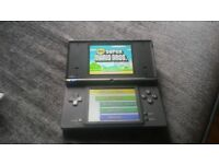 Nintendo Ds light handheld with charger and game