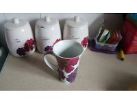 Tea,coffee,sugar canisters and 4mugs.