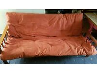 Double Futon/Sofa bed with terracotta reversible mattress, wooden frame