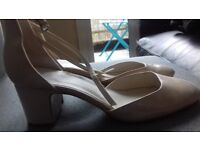 Lady's beige high heeled party shoe