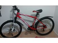"""Mountain bike 18"""" frame 26 """" wheels has 2 years cover from argos bought too small a bike for me"""