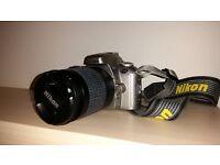 Nikon F55 camera with 28-100mm lens