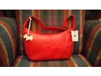 Brand new authentic Radley women's handbag in red leather with original dust cove
