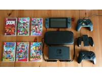 Nintendo Switch Console, sold with extra controllers,