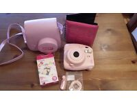 Pink Polaroid camera with accesories