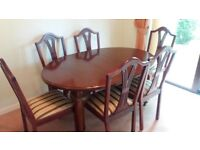 dark wood extending dining room table and 6 chairs
