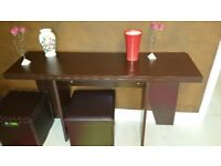 Table foldable into console