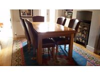 Extending Oak Dining Table (seats 8) with 5 Leather dining chairs