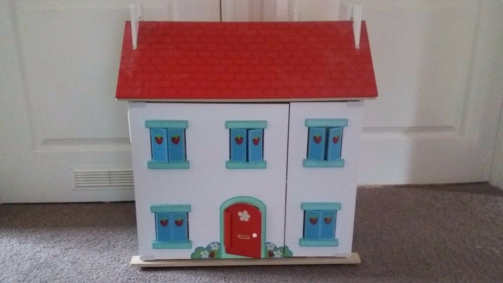 Dolls house for sale with furniture and people