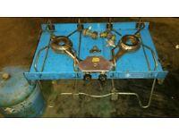 Folding camping gas stove.