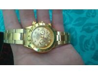 Gold rolex watch