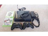 Xbox 360 E 250GB (Like new condition) + 2 Controllers + Headset + 2 Games