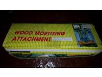 Wood mortising attachment.