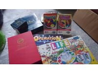 Collection of 7 board games (poker set, travel games, trivial pursuit, operation)