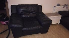 Oversized black leather armchair