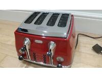 Delonghi 4 slice toaster boxed