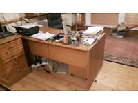 Sturdy office desk with swivel chair