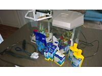 Two used Fish R Fun Hex Aquarium tanks, one in White, one in Grey