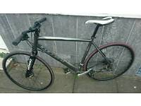 "Carrera gryphon 20"" hybrid bike."