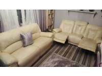 Pair of 3 seater cream Italian leather sofas 1 recliner 1 standard