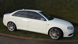 White Audi A4 with RS4 facelift