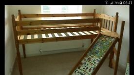 Single high sleeper bed with slide attachment.
