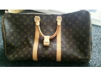 Louis Vuitton Louis Vuitton Keepall 60 cm travel bag in brown monogram canvas and natural leather