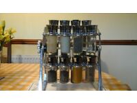 Stylish rotationg spice rack (includes 20 storage jars) great condition