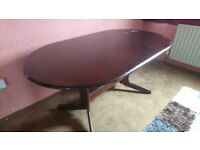 Dark wood dining table with 4 chairs