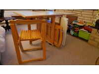 Table with 4 chairs good condition