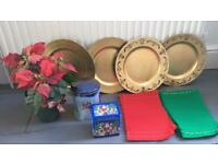 Christmas items 4 charger plates, placemats, artificial poinsettia & tins