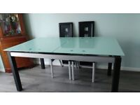 Toughened glass dining table for sale.