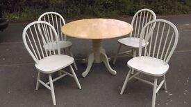 Painted pine, drop leaf dining table and four spindle back chairs.GREAT CONDITION .